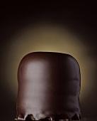 Chocolate-coated marshmallow on dark background