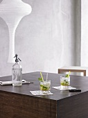 Two Mojitos on wooden table
