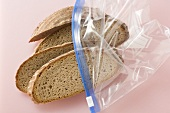 Four slices of mixed wheat and rye bread in a plastic bag