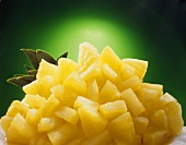 Pineapple chunks with pineapple leaves