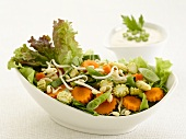 Mixed salad with carrots, lettuce and baby corn cobs