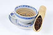 Cup of tea with Semen cassiae in a bamboo cane