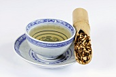 Bowl of tea with hare's ear root in a bamboo cane