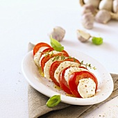 Tomato and mozzarella with herbs on a platter