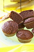 Several chocolate banana muffins in paper cases