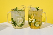 Pimm's punch and Mojito in jugs