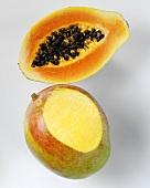 Mango with a slice removed and half a papaya