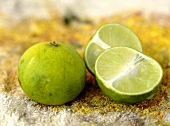 One whole and one halved lime