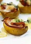 Baked potatoes with ham, cheese and spring onions