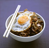 Nasi goreng with mushrooms and fried egg