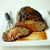 Roast beef with a slice on meat fork
