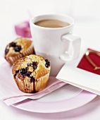 Blueberry muffins with a cup of tea