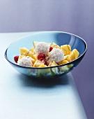 Mango salad with raspberries and coconut balls