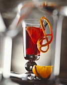 Campari cocktail with orange and cocktail cherry
