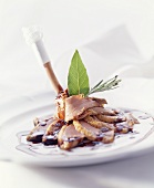 Duck leg with balsamic red wine sauce and herbs