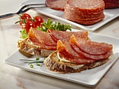 Open salami sandwiches on buttered bread