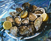 Plate of oysters and lemon halves