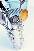 Various kitchen tools in a cutlery drainer