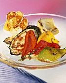 Roasted vegetables on a glass plate