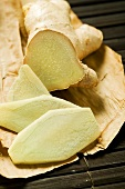 Fresh ginger root, slices cut (close-up)