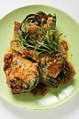 Stuffed artichokes with gratin topping
