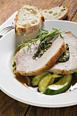 Loin of pork with herb stuffing on courgettes