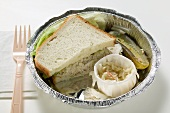 Tuna sandwich with coleslaw and gherkin in lunch box