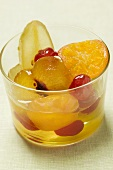 Candied fruit with mustard in glass