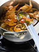 Crayfish stew in stew-pan on cooker