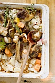 Roasted veal bones and vegetables (making veal stock)
