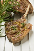 Grilled lamb cutlets with herb oil and rosemary