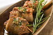 Belly pork rolls with tomato pesto and rosemary