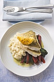Sea bass fillets with risotto and red chard