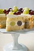 Grape cake, a slice cut, on cake stand