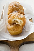 Fried pastries, sugared, on paper