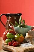 Fresh tomatoes, olives, bread, salt and terracotta jug