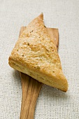 Triangular savoury puff pastry pasty on server