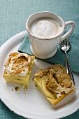 Two pieces of apple meringue cake with coffee