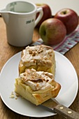Two pieces of apple meringue cake, fresh apples & milk