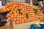 A heap of apricots at a market