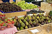 Fresh figs, cherries, grapes and berries at a market