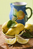 Lemon wedges and lemons with leaves