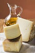 Three pieces of cheese and olive oil