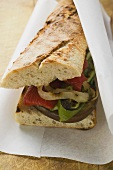Baguette with grilled vegetables on paper