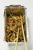 Remains of fried noodles in aluminium container