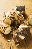 Assorted pretzel rolls on wooden background