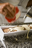 Making chocolate and cream terrine