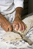 Making olive bread (dividing the dough into portions)