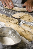 Making olive bread (forming into sticks)