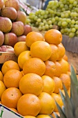 Oranges, apples and grapes at a market